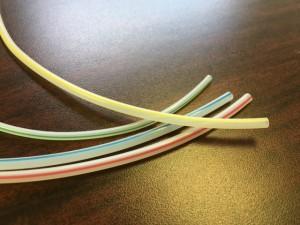 Striped fluoropolymer tubing